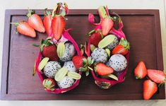 Tropical fruit salad in dragon fruit bowl