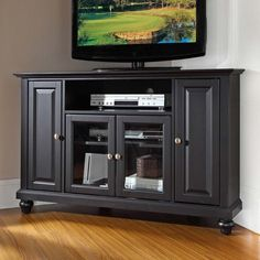Love this corner tv stand. - would work perfectly in my oddly long living room!