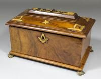 A 19th Century walnut rectangular Masonic Charity Box, the angled top decorated in gilt with square and dividers, on paw feet | The Canterbury Auction Galleries