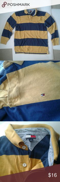 Long sleeve blue and yellow striped rugby polo This Tommy Hilfiger polo has big and bold stripes of yellow and blue and white buttons. The Hilfiger logo is placed subtly on the left chest. This XL long sleeve has a rugby look, you can see that the back hangs slightly lower than the front. No flaws on this pre-loved item. Ladies, this would make a great gift! Tommy Hilfiger Shirts Polos