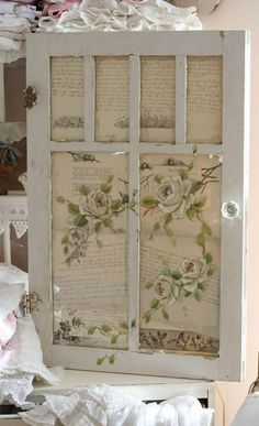 Paint and paper turn this vintage window into wall art