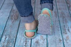 FREE Crochet Pattern: Women's Crochet Flip-Flops | These comfy flip-flop slippers feature a thick felt sole and are made with stretchy, comfy t-shirt yarn! Make yourself a pair and your feet will love you!