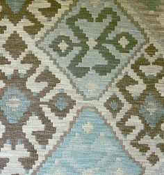 Kilim Upholstery Fabric Heavy weight upholstery fabric in the style of a turkish rug, in browns, aquas and beiges