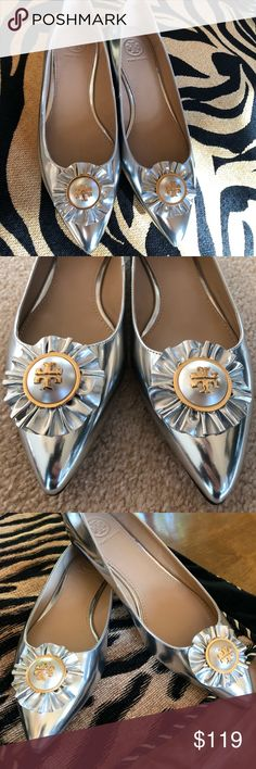 🆕💟TORY BURCH FLATS💟 Like jewelry for the feet, The Melody Flat is decorated with a logo-accented pearl encircled with a ruffle. An elongating silhouette done in metallic silver leather, it has a pointed to and an elegantly contoured notch collar. It can dress up any look by day or after dark. The left flat has a ding in the leather and will be reflected in the price. Padded leather footbed, leather sole and a non slip heel. BEAUTIFUL! Tory Burch Shoes Flats & Loafers