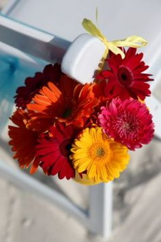chair flower decoration for the beach ceremony in Florida by Dallas wedding photographer | beach wedding photos | wedding flowers decoration on beach | destination wedding photographers