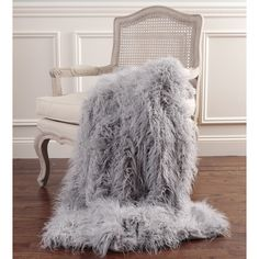 mongolian lamb faux fur throw blanketno royal would be complete without a luxurious textured blanket from