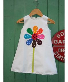 White dress daisy rainbow fish [and Louise Valentine] Girls Dresses Sewing, Sewing Kids Clothes, Toddler Girl Dresses, Little Girl Dresses, Baby Sewing, Baby Frocks Designs, Kids Frocks Design, Baby Outfits, Kids Outfits
