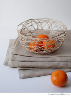 I need to make a couple of these for all our fruit!  the red thread string bowl tutorial