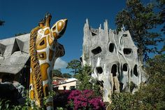 "Source: Hang Nga Guesthouse a.k.a Crazy House (Vietnam.) The house is owned by the daughter of the ex-president of Vietnam, who studied architecture in Moscow. It does not comply with any convention about house building, has unexpected twists and turns, roofs and rooms. It looks like a fairy tale castle, it has enormous ""animals"" like a giraffe and a spider, no window is rectangular or round, and it can be visited like a museum. from Shannon Mannila"