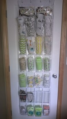 This is like what we have on the back of the door in Madelyn's nursery! Space saver meets organization! :)