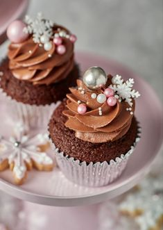 A stand-out addition to any festive get-together! Scrumptious chocolate flavoured cupcakes baked in a silver paper case, topped with a heavenly chocolate cream cheese frosting and decorated with a twinkling array of shimmered sugar pearls, silver sprinkle Holiday Cupcakes, Holiday Treats, Christmas Treats, Baking Cupcakes, Cupcake Recipes, Cupcake Cakes, Holiday Baking, Christmas Baking, Peggy Porschen Cakes