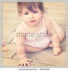 Adorable baby girl taken closeup - With Instagram effect by Melissa King, via Shutterstock