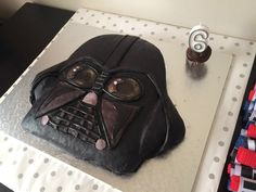 Darth Vader cake for a star wars party. plastic/Fondant icing with liquorice lines and a blue velvet cake underneath Blue Velvet Cakes, Fondant Icing, Star Wars Party, Bar Mitzvah, Party Printables, Evolution, Darth Vader, Plastic, Fondant