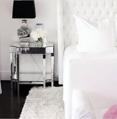 white bedroom with mirrored accents.