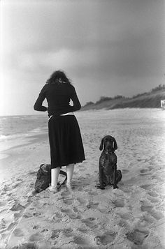 "Henri Cartier-Bresson was mistakenly credited for the beautiful ""A girl and a dog"" photo. All the credits should go to Lithuania-based Andrej Vasilenko, who snapped it back in 2007. Cartier-Bresson was dead at that time – as in not alive anymore."