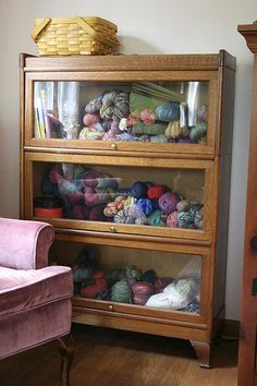 I have two of these cabinets (four shelves each) sitting in my garage...waiting for my sewing room!!