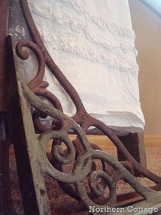 rusty iron brackets; just put some up in a large doorway at home...looks great!