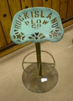 Tractor seat bar stool....so cute!