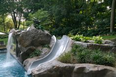 I love how this water slide is seemingly built right into the rock of the landscape.  I am putting an in ground pool in my backyard this year and would love to do something similar to this.  I like it because it looks really natural.