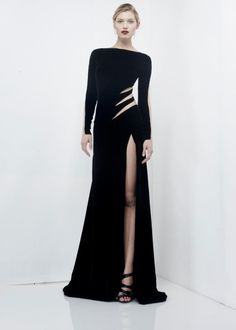 Black floor length gown with thigh high slit and claw slit