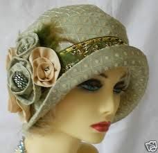 Green cloche with flower detail.