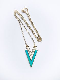 Stunning v shape geometric tribal necklace! Most popular style now! Great for all ages! Pendant is approx. 2-1/2 inch long. Chain length is