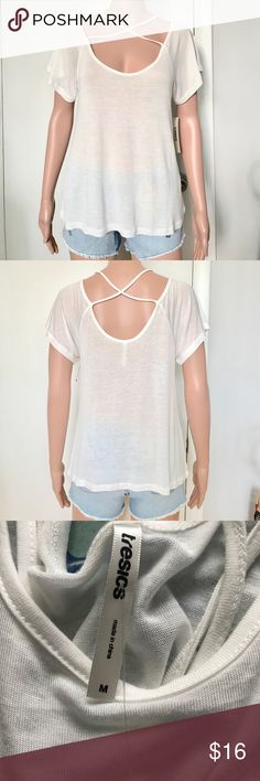 ✔️NWT Criss cross Top Brand new with tags. Size M. Price: Fair and reasonable offer immediately accepted. Shipping: Ships within 24 hours. Tresics Tops Blouses