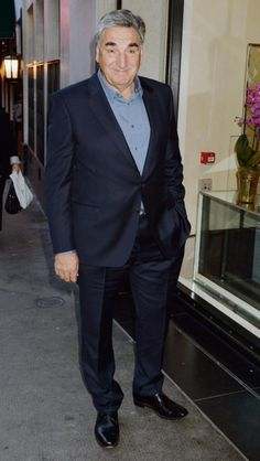 British actor Jim Carter arrives at The Ivy, as the cast of Downton Abbey attend a wrap party to celebrate the sixth and final season of the programme, in London, Saturday Aug. 15, 2015. (John Stillwell//PA via AP) ..