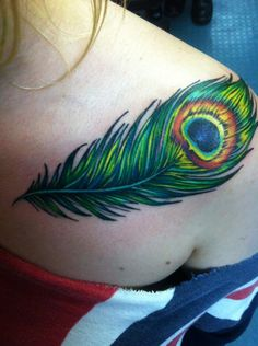 girl: peacock feather on my left collarbone/shoulder. tattooed by albert at industrial art tattoo, bayonne NJ. wetattooyou.com