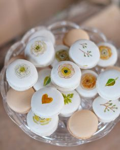 This bride hand-decorated macarons from Tee and Cakes for the dessert table at her DIY outdoor wedding.