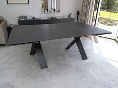 Extendable version of our dining table Xenon with BROMO Dekton top and graphite legs. Available in other sizes. Delivered to our client in Horsham. Bedroom Office, Modern Bedroom, Horsham, Dining Chairs, Dining Table, Leather Bed, Sofa Design, Contemporary Furniture, Graphite