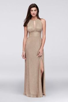 Glistening metallic fabric shines bright, creating an eye-catching halter gown for fancy occasions. The shape is kept simple, with a wide waistband and slit skirt, letting the shimmering fabric take c