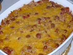 The Tall Girl Cooks: Cheesy Beans and Rice: I added 2 cups of cooked chicken and replaced ale for the water. It was fab! Taco Side Dishes, Mexican Side Dishes, Food Dishes, Main Dishes, Dinner Dishes, Rice Dishes, I Love Food, Good Food, Yummy Food