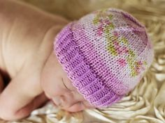 Not All Purple Hat 2 - beautiful baby hat, free pattern using special yarn to create the pattern.    !! Looks like the yarn is discontinued ;(  Still a great baby hat pattern. ...