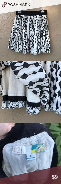 Black and white flowy skirt Black and white patterned flowy skirt! From Forever21, size small. Only worn a few times, in excellent condition. Feel free to make an offer or ask any questions! Forever 21 Skirts
