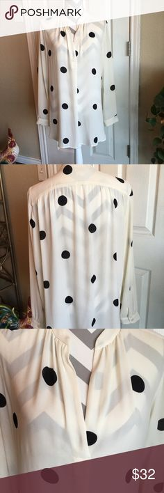 Loft polka dot tunic Black polka dots on a an off white tunic.  Worn one time!  No flaws.  Pair it with leggings or some skinny jeans or slacks.  Gorgeous addition! LOFT Tops Tunics