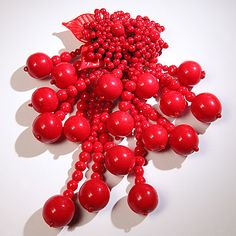 """@antiques-furniture-online #Linda #Horn #Antique #Beaded #Flower #Brooch in #Apple #Red, """"#vintage #handmade red bead clip #designed in a #flower #pattern with #clusters of small beads & #formed #leaves. From the flower are #hanging #bead #tassels in #graduating #sizes ending in large bead caps"""" Beautiful handmade one of a kind piece #classic & #modern with #bright #colors being the talk of the runway"""
