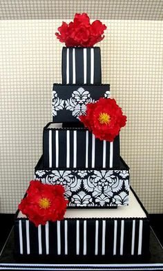 Love this cake. Between the huge red flowers and black and white damask, it is definately awesome