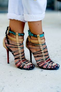 "A mix of colors, a subtle touch of python, and your feet are caged into sexy heels:)   Mezcla de colores, un toque sutil de ""python""!"