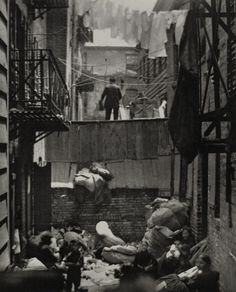 More than 100k immigrants lived in rear apartments that were unfit for human habitation.  Jacob Riis