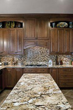 brown granite countertop brown tiled backsplash wood cabinet kitchen island stove top of Installing Ice Brown Granite Countertop for Your Home Design
