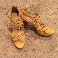 Nine West Strappy Tan Heels These are a pair of Nine West strappy stacked heels. They are a tan / nude color that is slightly more yellow in tone. Super flattering with the criss crossing straps and neutral color and incredibly comfortable with the stacked heel and platform bottom. In excellent used condition, with no real signs of wear or major scuffing. Perfect for summer and the warm weather with anything from skinny jeans to dresses! Nine West Shoes Heels