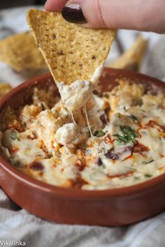 Creamy Cranberry and Chorizo Dip - Creamy and smoky this dip has it all-a blend of 3 cheeses, smoky chorizo and festive cranberries. Bring out the dunkers!
