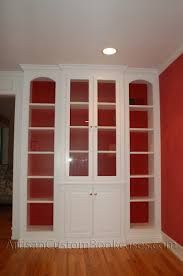painted builtin with glass doors artisan custom bookcases