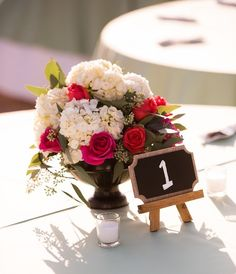 Mini chalkboard easels serve as table numbers. Too cute! {J.Perryman Photography}