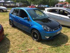 Blue Ford Fiesta mk6 with dark rims