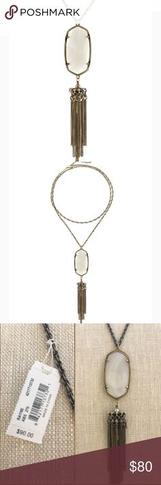 NWT Kendra Scott Rayne Antique Brass w/White Agate NWT Kendra Scott Signature Rayne necklace in Antique Brass with White Agate pendant and tassel. A must have fashion statement That can be worn with anything. Original jewelry pouch and care card included. Kendra Scott Jewelry Necklaces