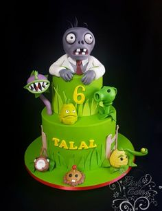 Chocolate Pinahata cakes loaded with Smarties, Astros and M&Ms Hand molded Zombie climbing out the top of the cake with plant characters below. Zombie Birthday Cakes, Zombie Birthday Parties, Leo Birthday, Zombie Party, Cupcakes Fondant, Cupcake Cakes, Zombies Vs, Halloween 1, Baby Party
