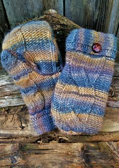 These multi-colored handmade mittens are fashion entirely from a cable-knit mohair upcycled sweater. They are then lined with a soft, warm fleece with a tapered to fit thumb for your comfort. They are finished with a faux wood brown button detail. Sweater Mittens, Mohair Sweater, Sweaters, Teaching Art, Cable Knit, Fingerless Gloves, Arm Warmers, Hand Sewing, Upcycle