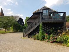 Home Farm Oast Studio - Farm stays for Rent in Kent, England, United Kingdom Kent England, Farm Stay, Ensuite Bathrooms, Wooden Decks, Large Bedroom, Table And Chairs, United Kingdom, Woodland, Relax